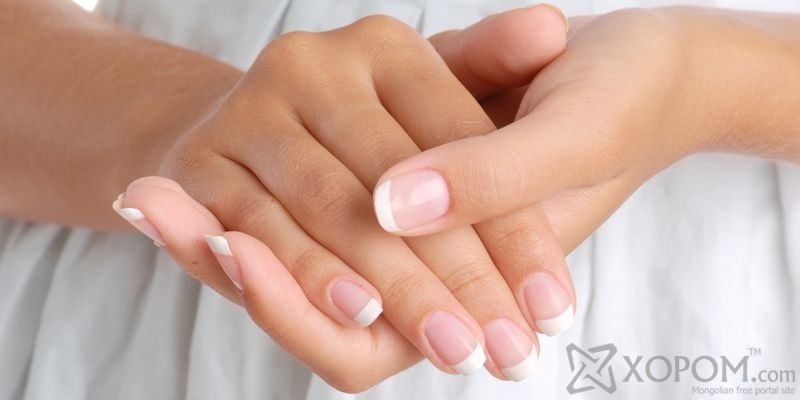 Girl hands on the white dress background, close-up